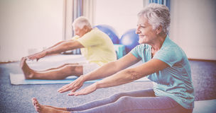 Seniors stretching legs Stock Images