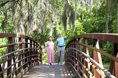 Seniors on a Stroll. Senior couple walking together in the park Stock Image