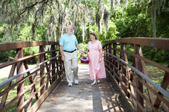 Seniors Strolling in Park Royalty Free Stock Photography