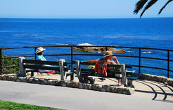 Seniors taking in ocean view at Heisler Park, Laguna Beach, CA Stock Photography