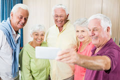 Seniors taking a selfie. In a retirement home Stock Photo