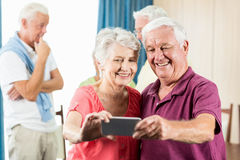 Seniors taking a selfie. In a retirement home Stock Photography
