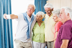 Seniors taking a selfie. In a retirement home Stock Image
