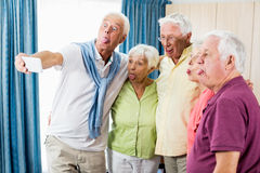 Seniors taking a selfie. In a retirement home Stock Images