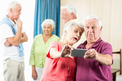 Seniors taking a selfie. In a retirement home Royalty Free Stock Photo