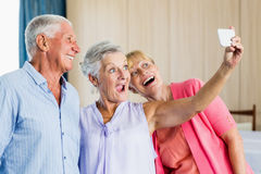 Seniors taking a selfie. In a retirement home Royalty Free Stock Images