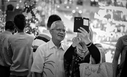 Seniors taking selfies Royalty Free Stock Photos