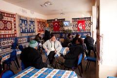 Seniors talk in a turkish tea house. Seniors talk in a traditional tea house in Goreme, Turkey. Turkey had the highest per capita tea consumption in the world Stock Image