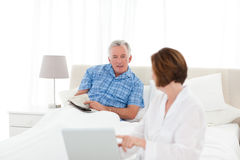 Seniors talking in the bed Royalty Free Stock Photo