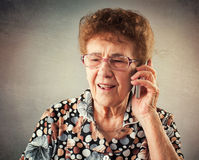Seniors talking mobile phone Royalty Free Stock Images