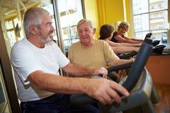 Seniors talking while spinning Royalty Free Stock Image