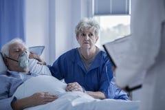 Seniors talking to doctor stock image