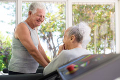 Seniors talking and working out in fitness club stock photo