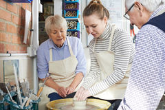 Seniors With Teacher In Pottery Class Royalty Free Stock Photo