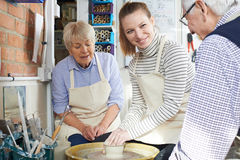Seniors With Teacher In Pottery Class. Senior Couple And Teacher In Pottery Class Royalty Free Stock Images