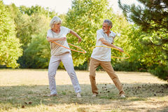 Seniors training with hula hoops Royalty Free Stock Photography