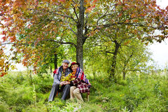 Seniors under tree Royalty Free Stock Photos