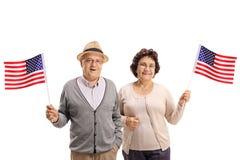 Seniors with USA flags Royalty Free Stock Photos