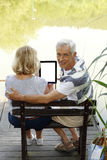 Seniors using digital tablet Stock Images