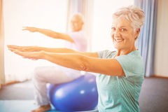 Seniors using exercise ball Stock Image