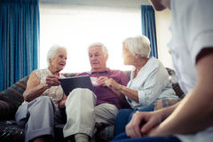Seniors using a tablet computer Royalty Free Stock Photography