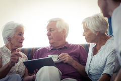 Seniors using a tablet computer Stock Image