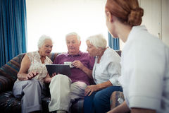 Seniors using a tablet computer Royalty Free Stock Photo