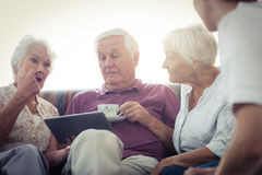 Seniors using a tablet computer Stock Photography