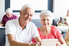 Seniors using a tablet Royalty Free Stock Images