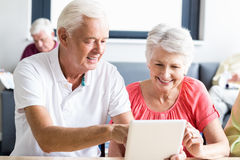 Seniors using a tablet Royalty Free Stock Photography
