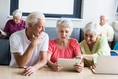 Seniors using technology Stock Photography