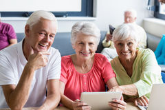 Seniors using technology. In a retirement home Stock Photos