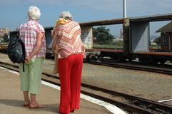 Seniors waiting for train Stock Photos