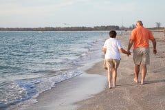 Seniors Walking on the Beach Royalty Free Stock Image