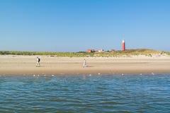 Seniors walking on beach of Texel island, Netherlands Royalty Free Stock Images