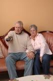 Seniors watching TV. Royalty Free Stock Images