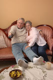 Seniors watching TV. Royalty Free Stock Photography