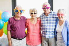 Seniors wearing funny glasses Royalty Free Stock Photography