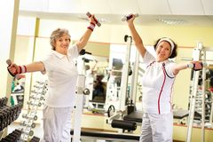 Seniors weightlifting Stock Images