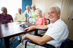 Seniors with wheelchair and walking aid Royalty Free Stock Photography