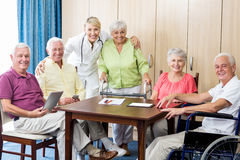 Seniors with wheelchair and walking aid Stock Photos
