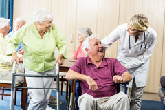 Seniors with wheelchair and walking aid Royalty Free Stock Images