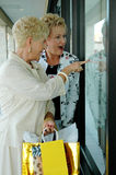 Seniors window shopping Stock Photo