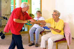 Seniors working with resistance bands. Stock Images