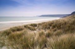 Sennen Cove beach and sand dunes before sunset Cornwall Stock Photo