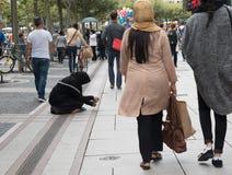 Sennior adult  beggar asking for money Royalty Free Stock Photos