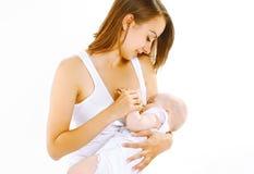Seno d'alimentazione della madre il suo bambino Fotografia Stock
