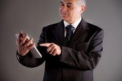 Senoir man using successfully a tablet Royalty Free Stock Image