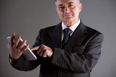 Senoir man using successfully a tablet Stock Photography