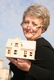 Senoir woman with house Stock Photos